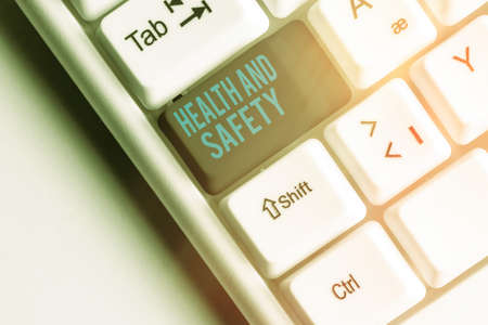 Handwriting text Health And Safety. Conceptual photo procedures intended to prevent accident in workplace Different colored keyboard key with accessories arranged on empty copy space