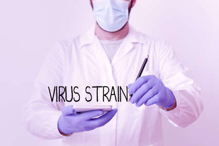 Text sign showing Virus Strain. Business photo showcasing Another genetic variant derived from the original microorganism Laboratory Technician Featuring Empty Sticker Paper Accessories Smartphone Reklamní fotografie