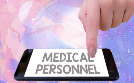 Word writing text Medical Personnel. Business photo showcasing trusted healthcare service provider allowed to treat illness Modern gadgets with white display screen under colorful bokeh background