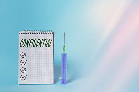 Conceptual hand writing showing Confidential. Concept meaning containing an individualal information whose unauthorized disclosure Set of medical equipment with notepad for health assessment 스톡 콘텐츠