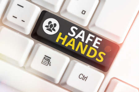Writing note showing Safe Hands. Business concept for Ensuring the sterility and cleanliness of the hands for decontamination Colored keyboard key with accessories arranged on empty copy space