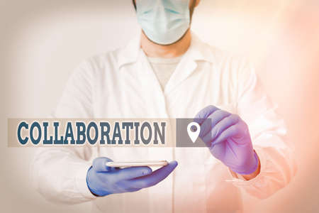 Handwriting text Collaboration. Conceptual photo cooperate with or willingly assist an enemy of one s is country Laboratory Technician Featuring Empty Sticker Paper Accessories Smartphone Stock fotó
