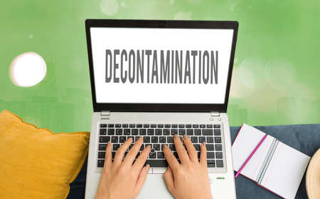 Word writing text Decontamination. Business photo showcasing neutralizing every presence of hazardous substances Modern gadgets with white display screen under colorful bokeh background