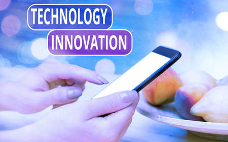 Conceptual hand writing showing Technology Innovation. Concept meaning significant technological changes of products Modern gadgets white screen under colorful bokeh background
