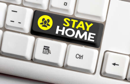 Writing note showing Stay Home. Business concept for not go out for an activity and stay inside the house or home Colored keyboard key with accessories arranged on empty copy space