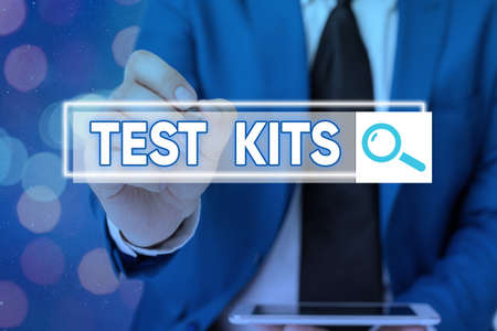 Writing note showing Test Kits. Business concept for tools used to detect the presence of something in the body Web search digital information futuristic technology network connection Banque d'images