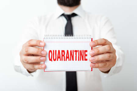 Word writing text Quarantine. Business photo showcasing restraint upon the activities of an individual or the transport of goods Model displaying different empty color notepad mock-up for writing idea