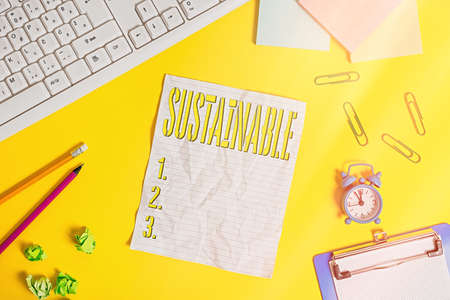 Writing note showing Sustainable. Business concept for the ability to be sustained, supported, upheld, or confirmed Flat lay above copy space on the white crumpled paper