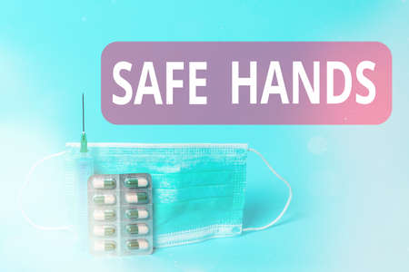Writing note showing Safe Hands. Business concept for Ensuring the sterility and cleanliness of the hands for decontamination Primary medical precautionary equipments for health care protection 免版税图像