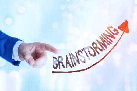 Writing note showing Brainstorming. Business concept for solving technique that involves spontaneous contribution Digital arrowhead curve denoting growth development concept