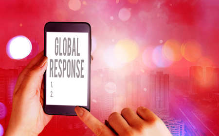 Word writing text Global Response. Business photo showcasing indicates the behaviour of material away from impact point Modern gadgets with white display screen under colorful bokeh background