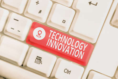 Text sign showing Technology Innovation. Business photo showcasing significant technological changes of products Different colored keyboard key with accessories arranged on empty copy space 免版税图像