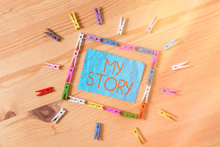 Conceptual hand writing showing My Story. Concept meaning the things or situations that have happened to someone in life Colored crumpled papers wooden floor background clothespin