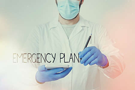 Text sign showing Emergency Plan. Business photo showcasing procedures for handling sudden or unexpected situations Laboratory Technician Featuring Empty Sticker Paper Accessories Smartphone
