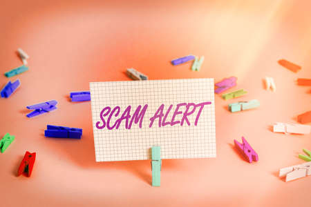 Writing note showing Scam Alert. Business concept for unsolicited email that claims the prospect of a bargain Colored crumpled rectangle shaped reminder paper light blue background