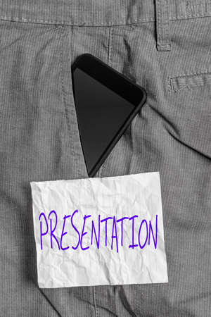 Text sign showing Presentation. Business photo text act, power, or privilege especially of a patron of applying Smartphone device inside formal work trousers front pocket near note paper Archivio Fotografico