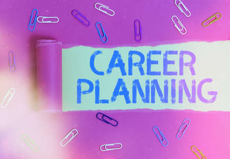 Conceptual hand writing showing Career Planning. Concept meaning Strategically plan your career goals and work success Rolled ripped torn cardboard above a wooden classic table