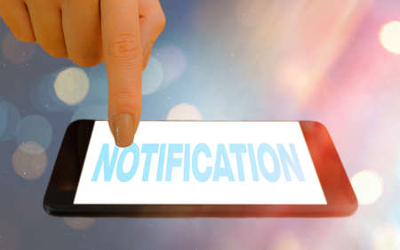 Conceptual hand writing showing Notification. Concept meaning act or instance of notifying, written matter that gives notice Modern gadgets white screen under colorful bokeh background