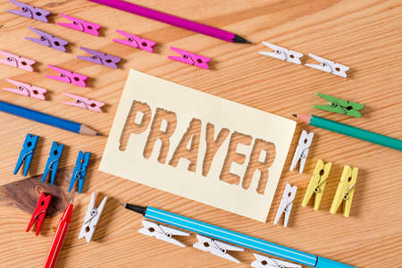 Handwriting text Prayer. Conceptual photo solemn request for help or expression of thanks addressed to God Colored clothespin papers empty reminder wooden floor background office Stock Photo