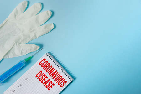Handwriting text writing Coronavirus Disease. Conceptual photo defined as illness caused by a novel virus SARSCoV2 Set of medical equipment with notepad for health condition assessment Reklamní fotografie