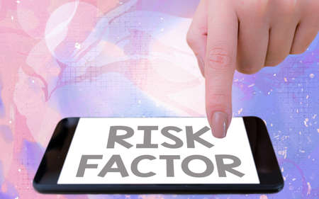 Word writing text Risk Factor. Business photo showcasing Characteristic that may increase the percentage of acquiring a disease Modern gadgets with white display screen under colorful bokeh background