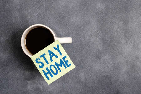 Word writing text Stay Home. Business photo showcasing not go out for an activity and stay inside the house or home Paper accesories with digital smartphone arranged on different background