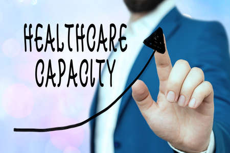 Conceptual hand writing showing Healthcare Capacity. Concept meaning maximum amount of patients provided with the right medical service Digital arrowhead curve denoting growth development concept