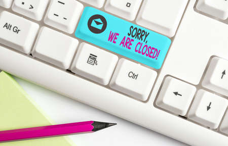 Handwriting text Sorry, We Are Closed. Conceptual photo apologize for shutting off business for specific time Different colored keyboard key with accessories arranged on empty copy space