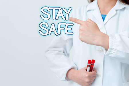 Writing note showing Stay Safe. Business concept for secure from threat of danger, harm or place to keep articles Empty sticker paper accessories smartphone with medical gloves on