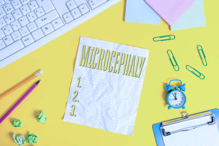 Writing note showing Microcephaly. Business concept for condition of abnormal smallness of circumference of the head Flat lay above copy space on the white crumpled paper Stockfoto