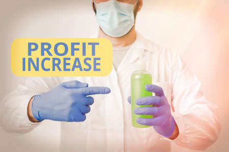Writing note showing Profit Increase. Business concept for the growth in the amount of revenue gained from a business Laboratory Blood Test Sample Shown For Medical Diagnostic