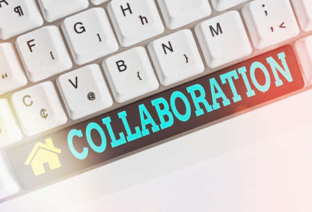 Text sign showing Collaboration. Business photo showcasing cooperate with or willingly assist an enemy of one s is country Different colored keyboard key with accessories arranged on empty copy space