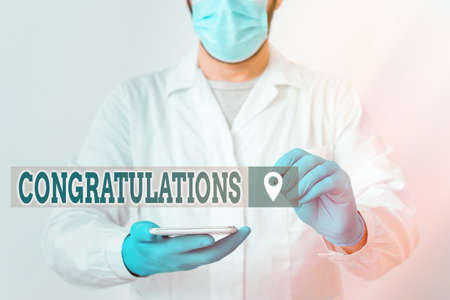 Handwriting text Congratulations. Conceptual photo a congratulatory expression usually used in plural form Laboratory Technician Featuring Empty Sticker Paper Accessories Smartphone