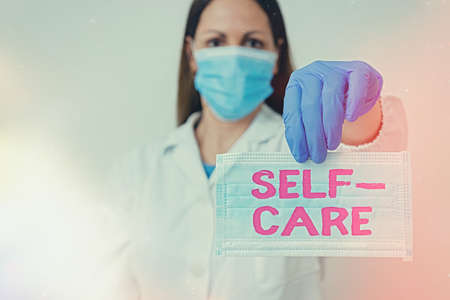 Conceptual hand writing showing Self Care. Concept meaning the practice of taking action to improve one s is own health Laboratory blood test sample for medical diagnostic analysis