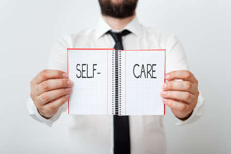 Word writing text Self Care. Business photo showcasing the practice of taking action to improve one s is own health Model displaying different empty color notepad mock-up for writing idea Stock fotó