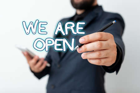 Text sign showing We Are Open. Business photo text no enclosing or confining barrier, accessible on all sides Model displaying different shots of holding pen ready for promotional use