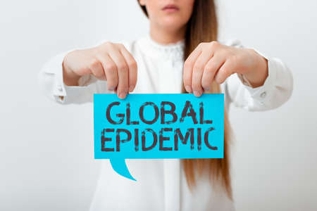 Conceptual hand writing showing Global Epidemic. Concept meaning a rapid spread of a communicable disease over a wide geographic area Displaying different color notes for emphasizing content 版權商用圖片