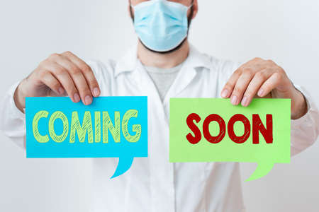 Word writing text Coming Soon. Business photo showcasing something is going to happen in really short time of period Laboratory Technician Featuring Empty Sticker Paper Accessories Smartphone