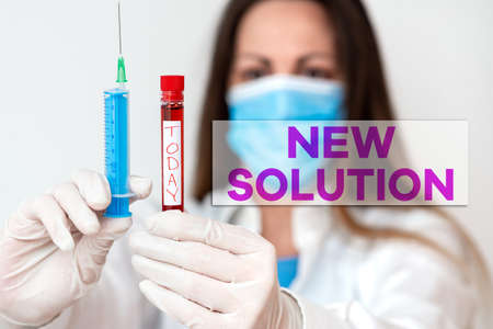 Conceptual hand writing showing New Solution. Concept meaning Modern Innovation Latest effective approach to a problem Laboratory blood test sample for medical diagnostic analysis 免版税图像