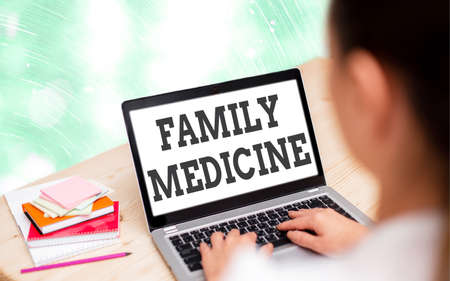 Handwriting text writing Family Medicine. Conceptual photo comprehensive health care for the individual and family Modern gadgets with white display screen under colorful bokeh background