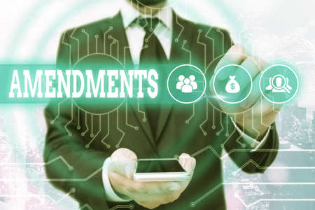 Text sign showing Amendments. Business photo showcasing process of amending a law or document by parliamentary. System administrator control, gear configuration settings tools concept