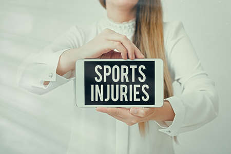 Text sign showing Sports Injuries. Business photo showcasing injuries that occur when engaging in sports or exercise Model displaying black screen modern smartphone mock-up for personal interest