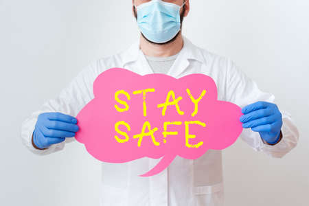 Text sign showing Stay Safe. Business photo showcasing secure from threat of danger, harm or place to keep articles Laboratory Technician Featuring Empty Sticker Paper Accessories Smartphone