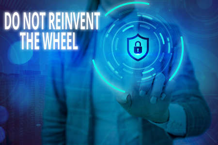 Conceptual hand writing showing Do Not Reinvent The Wheel. Concept meaning stop duplicating a basic method previously done Graphics padlock for web data security application system