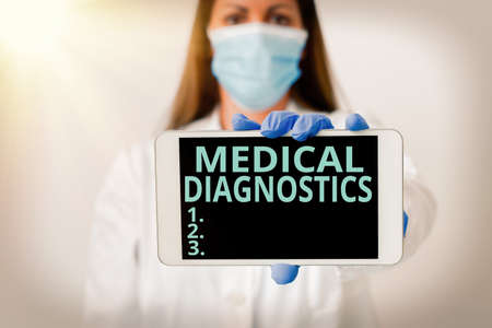 Writing note showing Medical Diagnostics. Business concept for act of identifying a disease from its signs and symptoms Laboratory technician featuring empty paper accessories smartphone Stok Fotoğraf