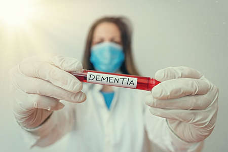 Writing note showing Dementia. Business concept for usually, a progressive condition marked by multiple deficits Laboratory blood test sample for medical diagnostic analysis
