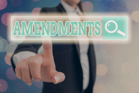 Conceptual hand writing showing Amendments. Concept meaning process of amending a law or document by parliamentary. Web search digital futuristic technology network connection