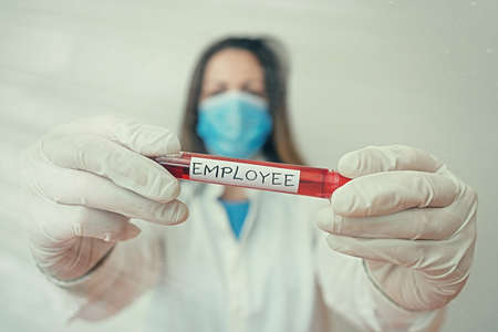 Writing note showing Employee. Business concept for one employed by another usually for wages or salary below the executive Laboratory blood test sample for medical diagnostic analysis
