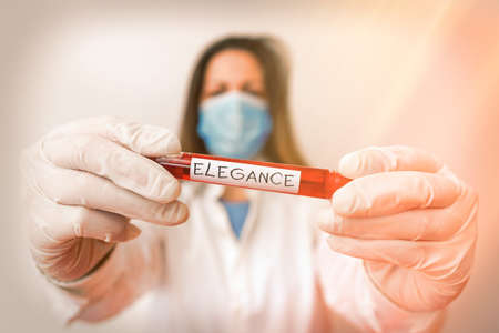 Writing note showing Elegance. Business concept for scientific precision, neatness, and simplicity of something Laboratory blood test sample for medical diagnostic analysis Stok Fotoğraf
