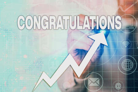 Writing note showing Congratulations. Business concept for a congratulatory expression usually used in plural form Arrow symbol going upward showing significant achievement Foto de archivo